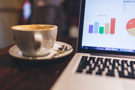 laptop-with-charts-and-coffee