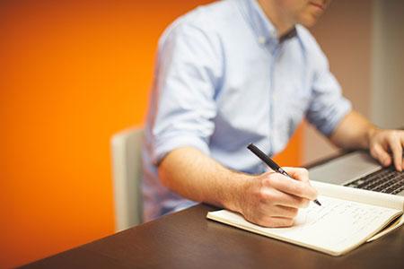 man-at-laptop-writing
