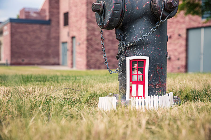 small-man-in-water-hydrant-house